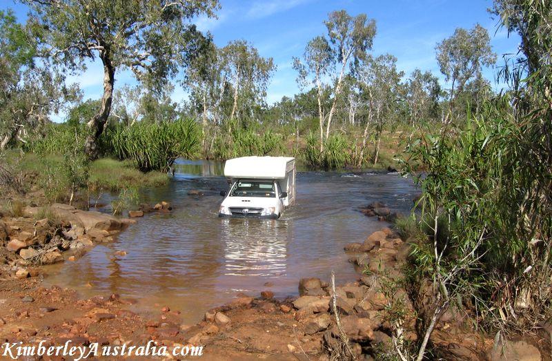 Hired campervan crosses a river