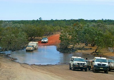 Four Wheel Drives At Creek Crossing On The Gibb River Road