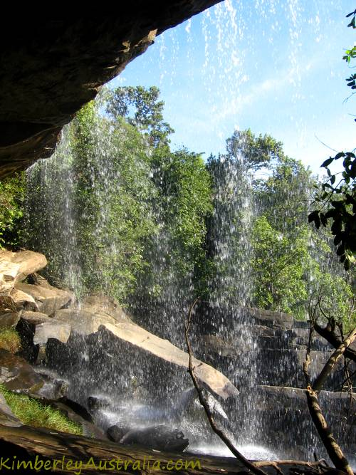 Standing behind the waterfall, looking out