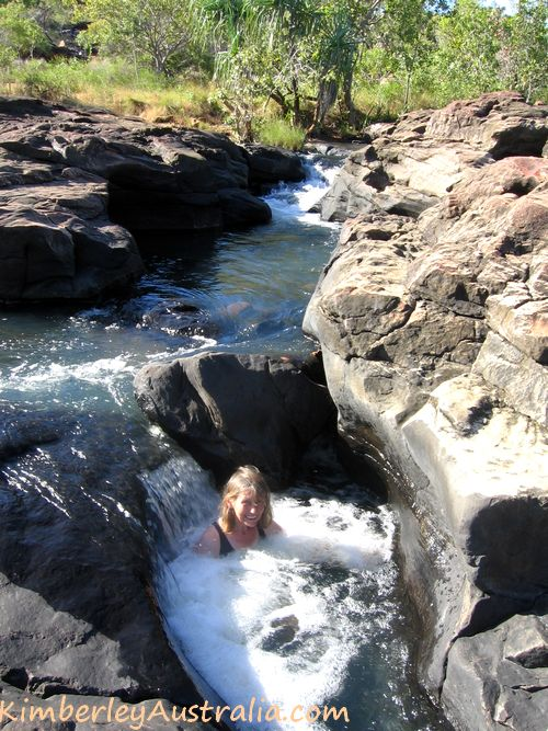 Sitting in a natural spa pool on the Mitchell Plateau