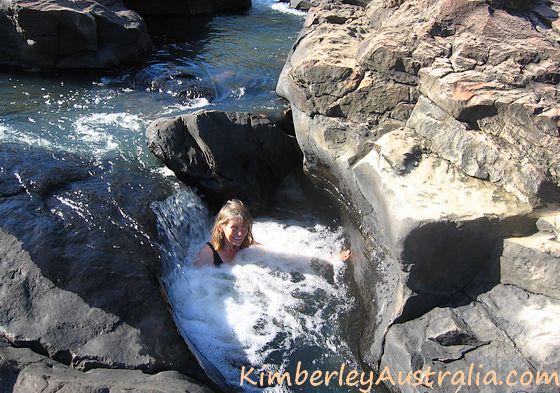 Sitting in the natural spas above Little Mertens Falls