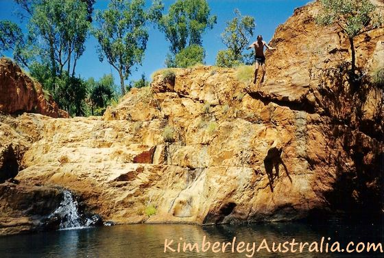 Guy jumping into one of the pools at Harry's Hole